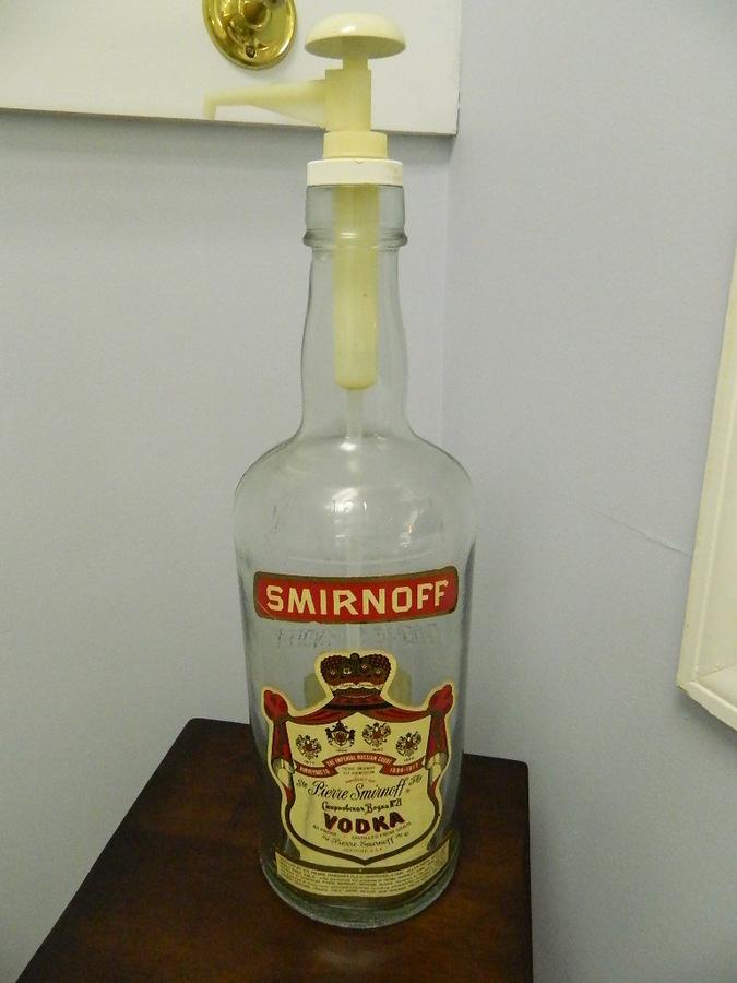 1 gallon smirnoff vodka bottle with plastic smirnoff pump dispenser