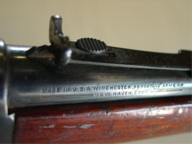 1876 winchester rifle value by serial number
